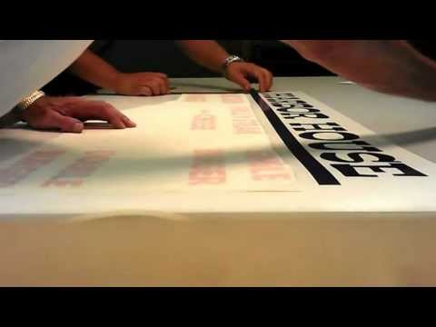 Applying vinyl to a multi colored menu sign