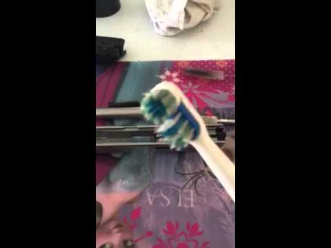 Gun cleaning with a power toothbrush