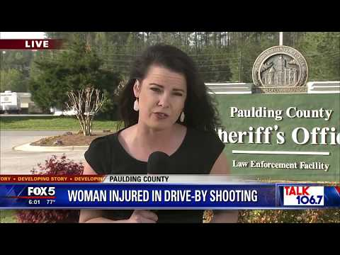 Woman injured in drive by shooting