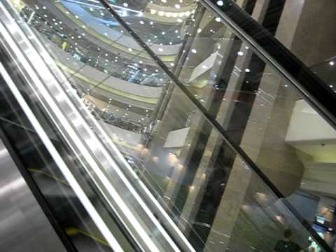 Going up the escalators in Times Square shopping centre (Hong Kong)