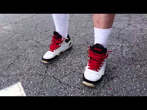 4b3d874f2c3 KKK member at Confederate flag rally confronted for wearing FUBU shoes