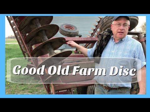old farm disc : old farm equipment getting the job done