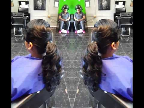 Curly ponytail with layer razor cut side bangs