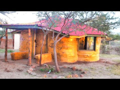 Earth Bag House Construction with Paper Bag Floor Walls | Superadobe Tiny Houses