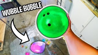 Download Bowling Ball VS Wubble Bubble from 100ft Drop! Video