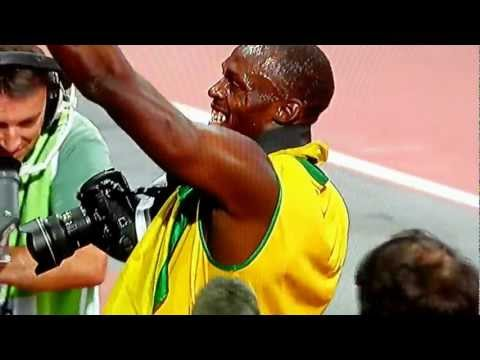 Usain Bolt Steals a Camera and Takes Pictures of Yohan Blake After Winning 200m Olympics 2012