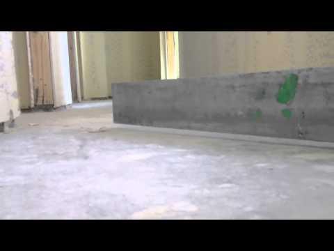 Checking a concrete floor for tolerance.