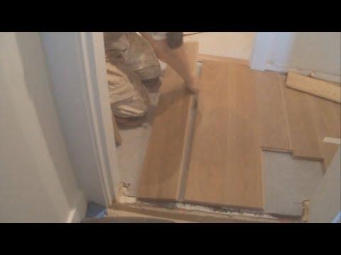 How To Installing a Hardwood Floor Glue Down Between Two Rooms in a Hallway Mryoucandoityourself