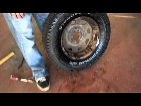 Putting new tire back on