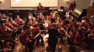 Onder leiding van Jan van Aart speelt de Harmonie D.O.V. uit Wijchen het muziekstuk Autumn Leaves (arrangement Peter Kleine Schaars). Het is uitgevoerd tijdens het concert