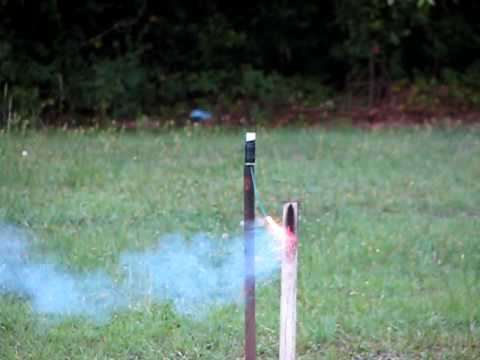Home made bottle rocket with fire cracker