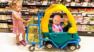 Funny Kid doing Shopping at the Supermarket and Baby Born Doll