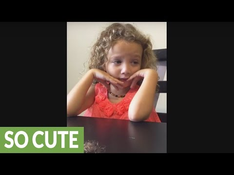 Little girl is sorry for cutting her sister's hair