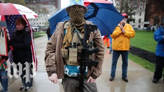 Armed protesters gather in Michigan to denounce stay-at-home orders