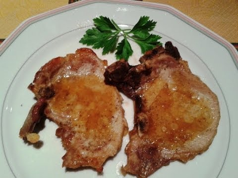 PORK CHOPS WITH ORANGE JUICE. SPANISH FOOD. EASY COOKING
