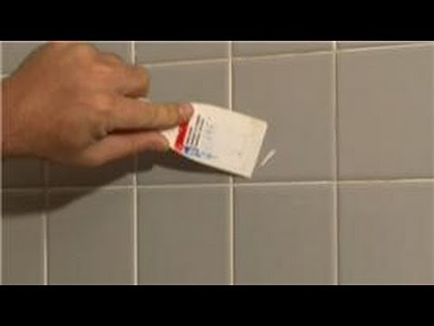 Bathroom Tiling : How to Remove Old Tile Adhesive From the Glazed Surface of Tiles