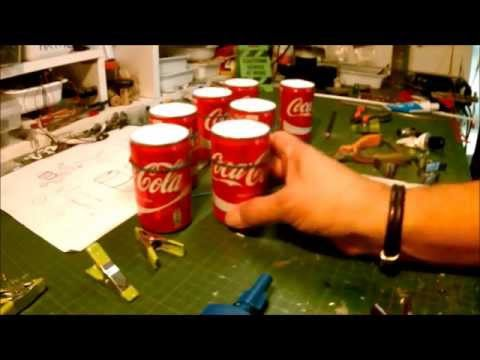 BUILT BARRELS OF OIL WITH BOXES OF COCA COLA FOR THE GARAGE/DIORAMA