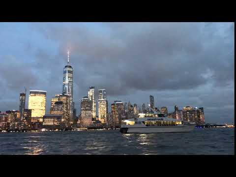 Lower Manhattan skyline timelapse at sunset, viewed from across the Hudson River