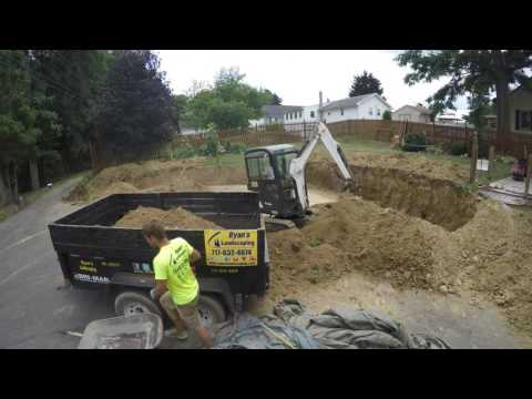 Excavation and removing dirt for retaining wall in Hanover PA. - time lapse - Ryan's Landscaping