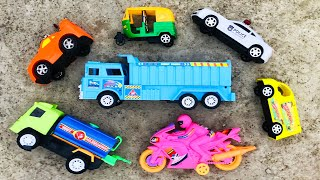 Searching & Finding some toy vehicles in a rooftop in the rainy day. Various toy vehicles were found