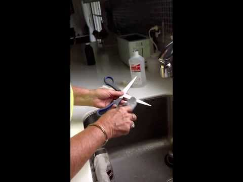 My Grandmom Showing Me How To Clean Off Scissors After Cutting Duck Tape