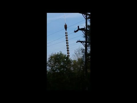 Chain Saws Hanging From Helicopter Near Power Lines (Ouch!)