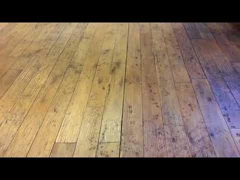 Hardwood Floor Buckling Up -  Before