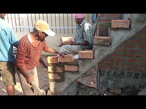 How to provide slope in Brick Wall construction on staircases