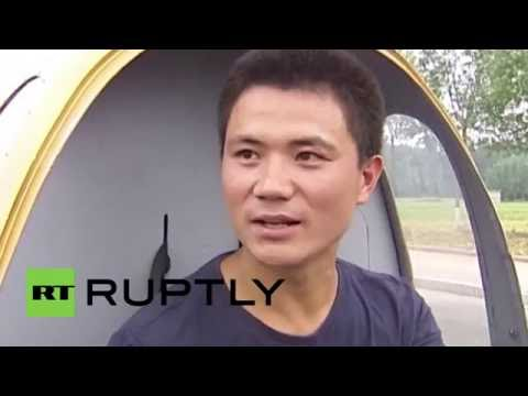 China: Farmer goes for a spin in his home made helicopter
