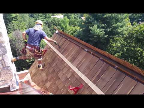 Hand nailing .. cedar roof shingles. By franklin custom copper works llc