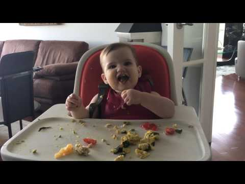 9 month old eating eggs and spinach