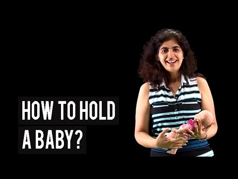 How to hold a baby while breastfeeding?