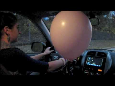 Driving a Car with a Helium Balloon: Physics