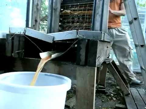 Making apple juice with a home-made hydraulic fruit press & grinder.