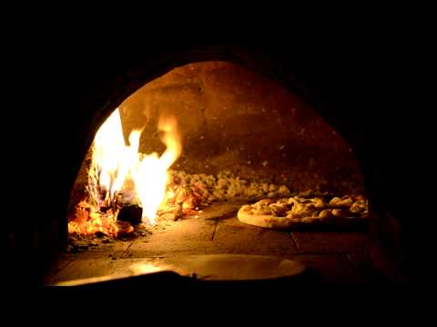 Cooking a pizza in under 3minutes in my homemade Clay Pizza Oven