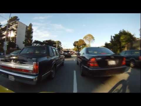 Lane splitting through heavy city traffic - DRZ Supermoto in San Francisco