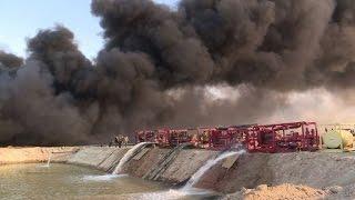 Iraqi firefighters battle to tame IS oil well fires