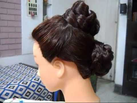 A Double Bun hairstyle for summer.