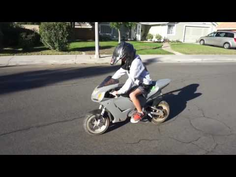 9 year old take's a street bike on a joyride down city streets