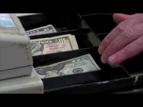 Teenager printing counterfeit money used a basic color printer