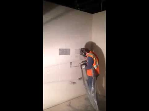 Dry Ice removing paint off concrete block wall