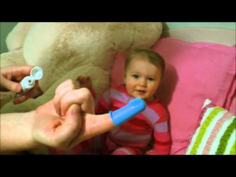 Brushing a baby's teeth