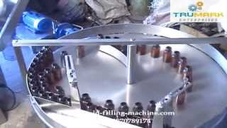 Automatic bottle filling capping machine manufacturer exporter, pharma liquid packaging line