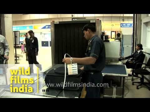 Baggage passes through X-ray at Jet Airways check-in counter