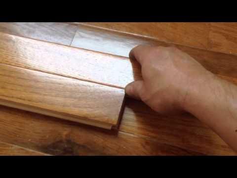 Wood flooring spline reverse the direction of floor