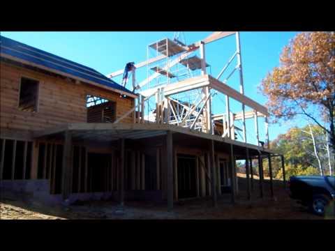 Building a Log home Part 9. Raising the ridge beam