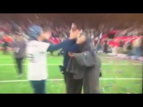 Randy Moss hugs Mrs Brady