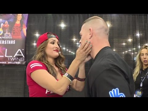 John Cena searches out Nikki Bella for a kiss at Wizard World Philadelphia: June 7, 2016