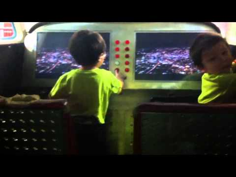 2 year old twins flying a plane