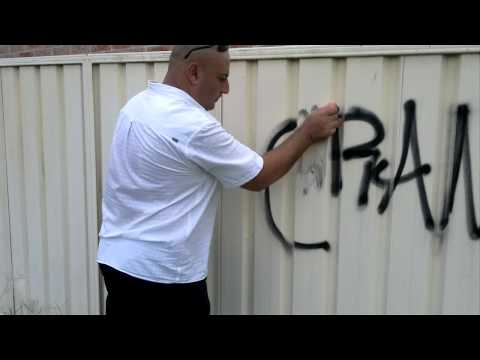 Removing Enamel Graffiti from a Colour Bond Fence that has been painted with Acryllic Paint..mp4